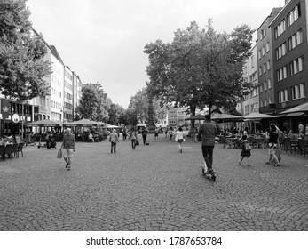 KOELN, GERMANY - CIRCA AUGUST 2019: Alter Markt (old market) historic square in the Altstadt (old town) is now the centre of night life with pubs and bars in black and white
