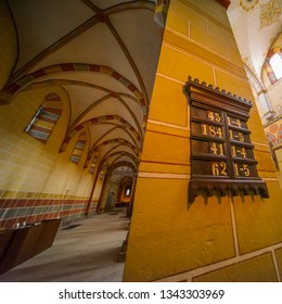 Koenigslutter, Germany, January 3., 2019: Interior view of the cathedral with a column on which the numbers of the hymns for the most powerful divine service are struck.