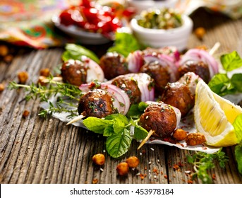Kofta skewers, meatballs and red onion with addition of fresh mint and thyme,delicious  oriental cuisine