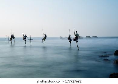 KOGGALA, SRI LANKA-January 13: Local fisherman is fishing in unique style on January 13 , 2013 in Koggala, Sri Lanka. So called stilt fishermen can only be found in Indian ocean.