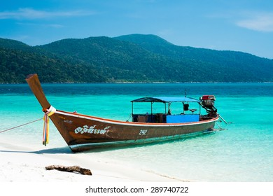 KOH ADANG, THAILAND - FEB 21: Crowded tourists and  a lot of local wooden boats during Chinese New Year 2015 at Adang Island  near Koh Lipe in  the southern of Thailand on February 21, 2015.