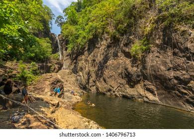 Koh Chang, Thailand - April 12,2019 : Many tourists travel at Klong Plu Waterfall in Ko Chang, Trat,Thailand on April 12,2019.