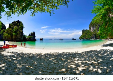 Koh Hong, Thailand - April 30, 2015: White sand beach with some tourists in the background.