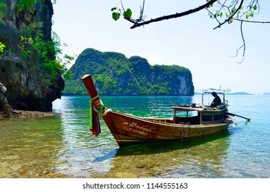 Koh Hong, Thailand - April 30, 2015: Long tail boat mooring at Koh Lading, one of the Hong islands in the Andaman Sea.