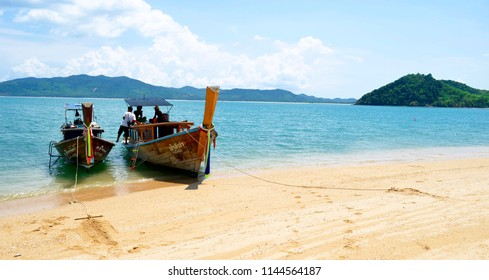 Koh Hong, Thailand - April 30, 2015: Long tail boats mooring at Koh Nok with Koh Yao Yai and Koh Yao Noi in the background.