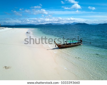 KOH KHANG KHAO, THAILAND - DECEMBER 28, 2017 - A traditional Thai longtail boat anchored on Koh Khang Khao island near Koh Phayam