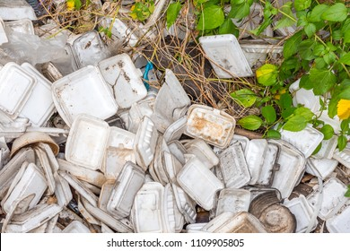 Koh Kong, Cambodia - January 3, 2017: Disposable foam food containers on a dump. The waste problem is the dark side of street food abundance in Asia.