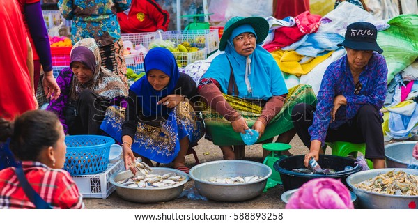 KOH KONG - JANUARY 3: Fish sellers (unidentified) on the central market in January 3, 2017 in Koh Kong, Cambodia.
