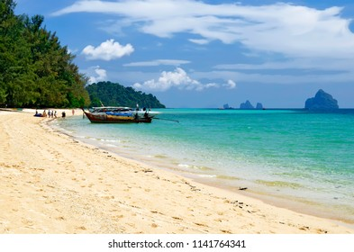 Koh Kradan, Thailand - April 19, 2017: Tourists arriving on Koh Kradan by long tail boat and speedboat.
