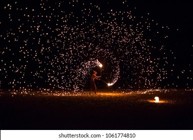Koh Lanta, Thailand - March 25, 2017: An unidentified performer uses fire in his act on the beach