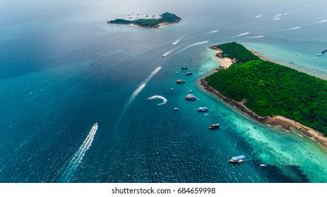 Koh Larn island peaceful and popular tourist destination. Beautiful landscape of Thailand sea and boats.Speed boats on crystal clear water. Pattaya city,Thailand.