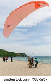 Koh Larn, Pattaya, Thailand - September 8, 2017: Tourists are preparing to fly at powered paraglider