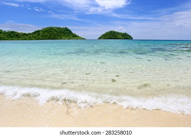 Koh Lipe, Satun, Thailand Beautiful crystal clear Emerald sea with mountains and blue sky