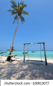 Koh Lipe Seat tied with rope on beach and Coconut tree