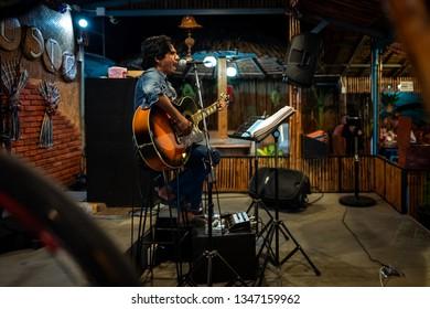 Koh Lipe, Thainald - February 20, 2019: A musician singing in a bar.
