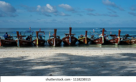 Koh Lipe/Thailand - 03 21 2017: Fishing wooden boats are parked on the beach.