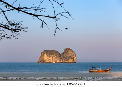 Koh ma (hourse island) and long tail boat at Koh Ngai island on the southern andaman coast, Trang province, Thailand