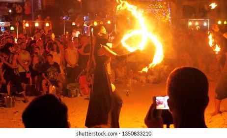 koh Phangan / Thailand - 20 March 2019: Fire Show on the Haad Rin Beach at Full Moon Party in Koh Phangan island, Thailand
