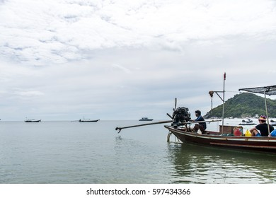 Koh Phangan thailand 28.09.2015 -Thai traditional longtail boat with big diesel engine in action smoke pollution