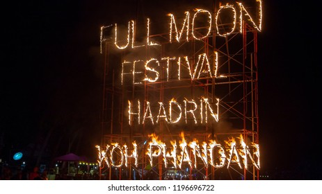 KOH PHANGAN, THAILAND - MARCH 02, 2018 : Full Moon Party fire sign on Haad Rin beach in island Koh Phangan, Thailand. Event now attracts anywhere about 30,000 party-goers on a normal month