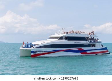 KOH PHANGAN, THAILAND - MARCH 05, 2018 : Lomprayah high speed catamaran leaves, conveying passengers from Bangkok to Samui and Phangan port island. Island Koh Phangan, Thailand