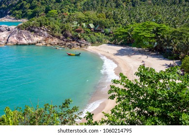 KOH PHANGAN, THAILAND - MARCH 15, 2018 : Than Sadet beach and sea water waves. Koh Phangan Island is one of the most popular destinations for tourists