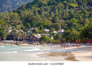 KOH PHANGAN, THAILAND - MARCH 15, 2018 : Thong Nai Pan Noi beach and sea water waves. Koh Phangan Island is one of the most popular destinations for tourists