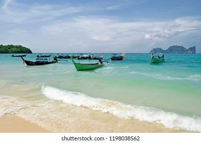 Koh Phi Phi Don, Krabi province, Thailand - April 26, 217: Long tail boats mooring in the Tonsai bay with Koh Phi Phi Leh in the background.
