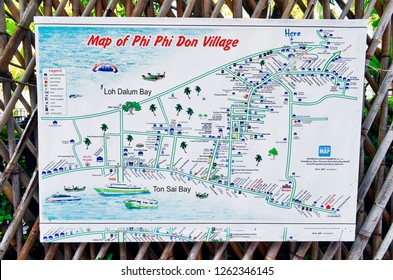 Koh Phi Phi Don, Krabi province, Thailande - April 25, 2017: Map of Phi Phi Don Village displayed on a bamboo fence in a footpath to help visitors find their way on the island.