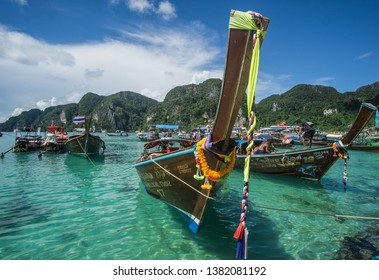 Koh Phi Phi / Phi Phi Islands / Thailand - September 27 2018 Touring around this amazing Island that has one of the most beautiful beaches in Thailand with those iconic longtail boats everywhere.