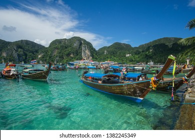 Koh Phi Phi , Phi Phi Islands / Thailand - September 27 2018 Touring around this amazing Island that has one of the most beautiful beaches in Thailand with those iconic longtail boats everywhere.