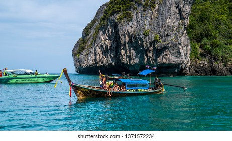 Koh Phi-Phi, Thailand - December 12, 2013: Travelling around with a local boat in Koh Phi-Phi, Thailand