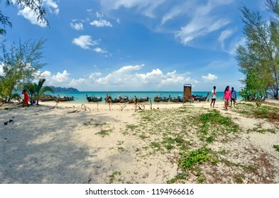 Koh Poda, Thailand - April 27, 2015: Long tail boats mooring at the beach with the Ao Nang bay in the background.