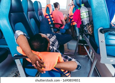 Koh Rong / Cambodia - 12/06/2018: Man sleeping on the speed ferry