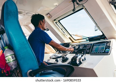 Koh Rong / Cambodia - 12/06/2018: Speed ferry captain controls the ship