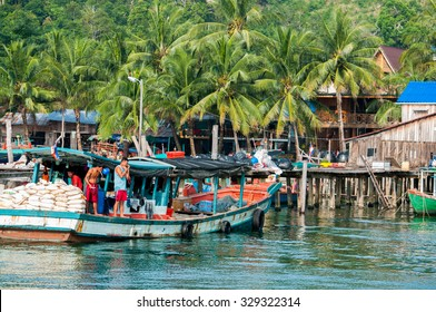 KOH RONG ISLAND, CAMBODIA - SEPTEMBER 23, 2015: Fishermen are at the pier of Koh Tui village, that is located in the south of Koh Rong island, Sihanoukville, Cambodia.