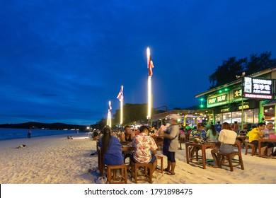 Koh Samet, Thailand-July, 2020 : Tourists on beach front restaurants at Sai Kaew beach on the island in Rayong, Gulf of Thailand.