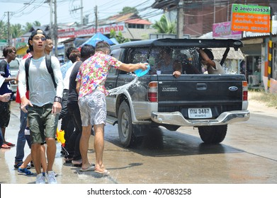 Koh Samui, Thailand - April 13, 2016: Thais and tourists shooting water guns, pour water on each other and having fun at Songkran festival, the traditional Thai New Year
