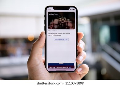 Koh Samui, Thailand - April 15, 2018: Man hand holding iPhone X with Apple Pay on the screen. iPhone 10 was created and developed by the Apple inc.