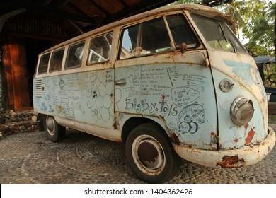 KOH SAMUI, THAILAND - FEBRUARY 7, 2014: Legengary retro car Volkswagen T1 (hippie bus), blue vintage minivan on Koh Samui island (Thailand)