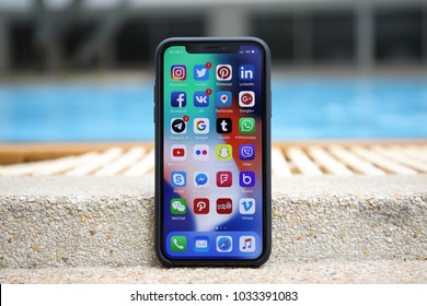 Koh Samui, Thailand - January 22, 2018: iPhone X with social network on the screen. iPhone 10 was created and developed by the Apple inc.