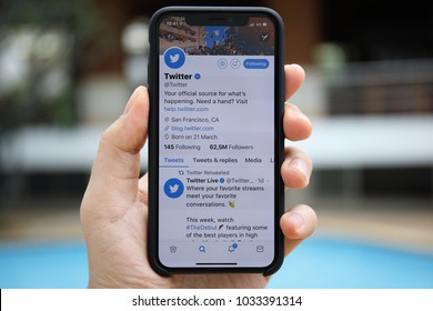Koh Samui, Thailand - January 22, 2018: Man hand holding iPhone X with social networking service Twitter on the screen. iPhone 10 was created and developed by the Apple inc.