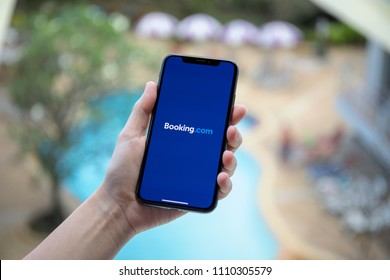 Koh Samui, Thailand - January 31, 2018: Woman hand holding iPhone X with application Booking.com online hotel reservations on the screen. iPhone 10 was created and developed by the Apple inc.