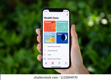 Koh Samui, Thailand - March 21, 2018: Woman hand holding iPhone X with app Health Data on the screen. iPhone 10 was created and developed by the Apple inc.