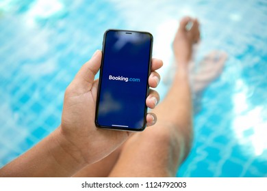 Koh Samui, Thailand - March 22, 2018: Man hand holding iPhone X with application Booking.com online hotel reservations on the screen. iPhone 10 was created and developed by the Apple inc.