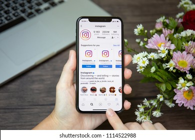 Koh Samui, Thailand - March 23, 2018: Woman hand holding iPhone X with social networking service Instagram on the screen. iPhone 10 was created and developed by the Apple inc.