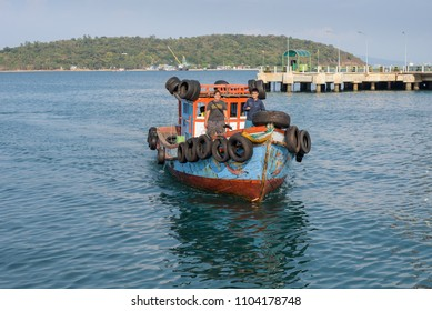 Koh Sichang, Thailand - January 30, 2018: The smiling unidentified woman and man standing on the boat which is entering Koh Sichang or Sichang island port.