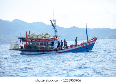 koh tao surathani thailand - march 6,2018 : thai fishery boat approach to drop fishery trapping to under sea water in koh tao surathani southern of thailand