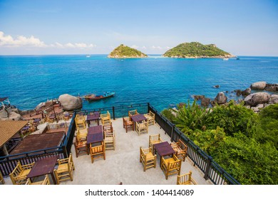 KOH TAO, THAILAND - APRIL 2019: Outdoor restaurant with beautiful sea view at Koh Tao. Exotic hotel restaurant with sea view in Thailand.