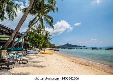 KOH TAO, THAILAND - March 2019: Tropical paradise sandy beach at Koh Tao island, Koh Samui, Thailand. Beach Holiday in Thailand. Tropical Thai beach on sunny day.